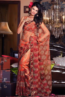 Enchanting Peach color Embroidery Bollywood Net sari.